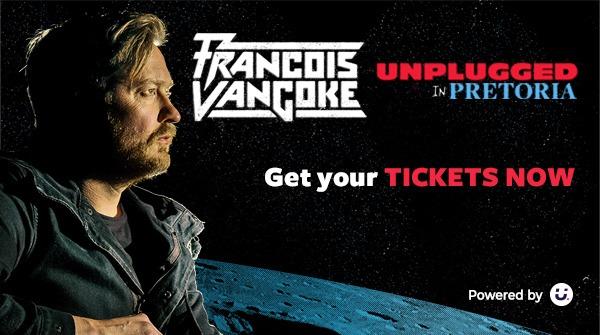 Francios van Coke sitting with his guitar in space
